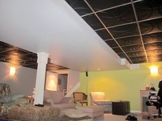 When installed, Orb Ceiling Tiles create a cool, repeating pattern of interlocking circles. Drop Ceiling Tiles, Dropped Ceiling, Ceiling Installation, Indoor Air Quality, Basement Remodeling, Repeating Patterns, Minimalism, Cool Stuff, Design