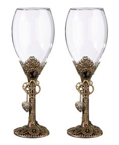 Ornate bronze detail complimented with keys, gears and clocks make these toasting glasses a must have steampunk wedding accessory for the reception. Glasses are