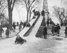 January 25, 1930: Youngsters on the Boston Common welcomed the announcement from the Boston Park Department that sliding conditions were good on the toboggan slide situated near the Soldiers' and Sailors' Monument.