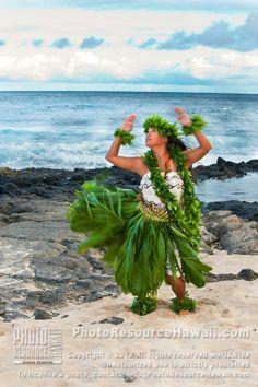 Kahiko hula dancer by the ocean, O'ahu.