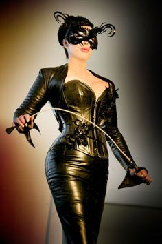 Leather Hypnosis Mistress in black leather corset and black leather skirt