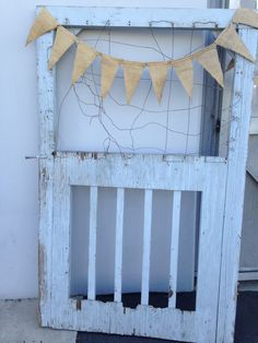 Backdrop or Photo Booth: Salvage Gate. Add goofy glasses