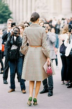 Look at those sleeves! Giovanna Battaglia in a checked, full-skirted Prada coat, with a thin leather belt, green suede pumps…
