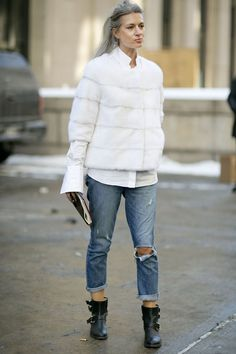 Sarah Harris added polish to boyfriend jeans with a luxe white fur and white button-down. Street Style at New York Fashion Week #NYFW