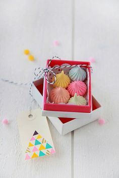 Fun Favors: Little box of meringues. You can create all kinds of shapes, it's sweet, decadent and easy to colour! Whip egg whites into peaks with castor sugar, and then fold in icing sugar with a spatula to stiffen up my meringue nicely.