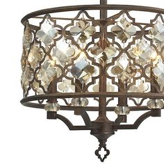 The Armand collection reveals an intricate laser cut pattern adorned with amber teak crystals. The crystals are designed to mimic the shape of the openings in the Weathered Bronze finished metalwork, refining the balance of the contrasting materials.