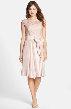 Free shipping and returns on Adrianna Papell Mixed Media Fit & Flare Dress at Nordstrom.com. This cocktail dress has a demure lace bodice and shimmering mid-length skirt coordinated by an enchanting dusty-rose hue and tied with a full bow at the waist.