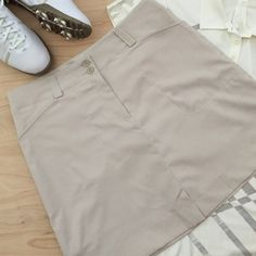 Nike Golf Skirt Khaki Colored Nike Dri-Fit Golf Skirt. Attached Shorts. Button and Zip Front. Front Slant Pockets. Faux Back Pockets. Polyester/Spandex. Machine Wash. Size 8No Trades or PayPal Nike Skirts