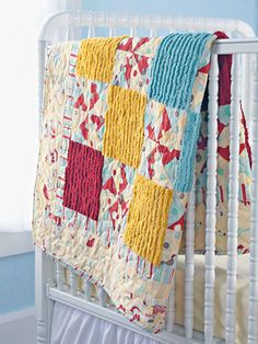 Pinwheel Baby Quilting Project - Soft chenille and polka-dot pinwheels make this vintage-inspired design the perfect gift to celebrate a baby's birth. A mixture of blue, pink, and yellow fabric allows this quilt to be used in a boy's or girl's room.  Get instructions for the pinwheel baby quilting project.