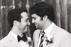 Two grooms gazing romantically - gay wedding