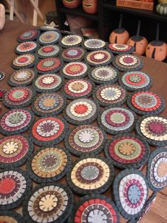 Large penny rug table runner that I stitched up from a Threads That Bind kit. Designer is Shawn Williams