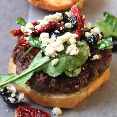 LAMB BURGER ~ a lively flavor reminiscent of a lamb gyro. The burger is enhanced by a tangy topping of feta, arugula, olives, and sun-dried tomatoes Lamb Burger Recipes, Best Burger Recipe, Sandwich Recipes, Fries Recipe, Popular Recipes, Great Recipes, Favorite Recipes, Dinner Recipes, Potluck Recipes