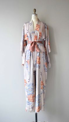 Antique 1930s airy silk kimono with abstracted floral print and silk tie sash belt. ✂-----Measurements fits like: free size bust: free waist: free length: 55 brand/maker: n/a condition: a stain at one shoulder, see close up photo ✩ layaway is available for this item to ensure a good fit, please read the sizing guide: http://www.etsy.com/shop/DearGolden/policy ✩ visit the shop ✩ http://www.DearGoldenVintage.etsy.com
