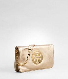 Loveeeeeeeee this Tory Burch clutch in Gold/Gold