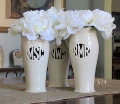 Personalized monogram vases. They can keep their bouquets in them and still use them after the wedding!