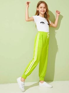 To find out about the Girls Neon Lime Striped Tape Side Sweatpants at SHEIN, part of our latest Girls Pants & Leggings ready to shop online today! Teenage Girl Outfits, Kids Outfits Girls, Cute Girl Outfits, Girls Fashion Clothes, Tween Fashion, Teen Fashion Outfits, Cute Casual Outfits, Girl Fashion, Stylish Dresses For Girls