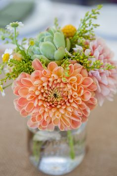 Bright orange summer dahlia and succulent centerpiece in mason jar with yellow billy balls. Campovida wedding, photography by Jenna Beth Photography. Flowers by Lily + Mint. www.lilyandmint.com