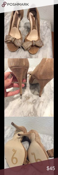 NWOT  leather d'Orsay peep toe final price leather gold peep toe heels with rhinestone bow make these heels shine. have only Been worn inside. This brand is sold in Nordstrom and blooming dales no longer available in this style boutique 9  Shoes Heels