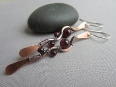 A personal favorite from my Etsy shop https://www.etsy.com/listing/232369656/copper-hammered-earrings-garnet-earrings