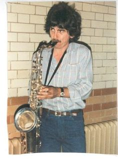 George playing a tenor sax that belongs to Tom Scott at Friar Park, 1988
