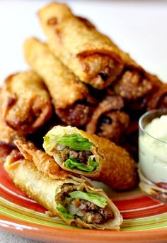 Tacos and Egg rolls get rolled up together in this fun and delicious appetizer, with an avocado cream sauce for dipping!