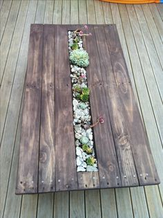 Succulent pallet table - made from an old pallet. Idea thanks to http://www.faroutflora.com/2011/06/04/diy-succulent-pallet-table/