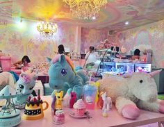 The cafe is located in Bangkok, Thailand, and is filled with plushies, My Little Pony toys, and a bunch of other unicorn paraphernalia. Unicorn Cafe, Unicorn Rooms, Unicorn Decor, My Little Pony, Rainbow Pasta, Cafe Japan, Kids Ride On Toys, Unicorn Pictures, Unicorn Outfit