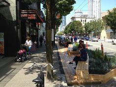 Park-ing Day Make-shift outdoor seating with temporary landscaping in the streets.