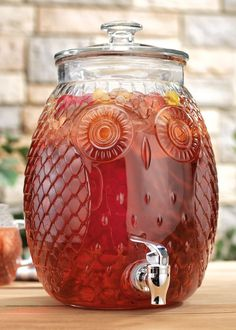 """This beautiful, glass <a href=""""https://www.everythingkitchens.com/home-essentials-owl-glass-beverage-dispenser-2-3-gal-8021.html"""" target=""""_blank"""">beverage dispenser</a>."""