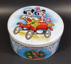 Rare Vintage Disney Mickey Mouse & Minnie Mouse in a Red Classic Car Round Tin Container https://treasurevalleyantiques.com/products/rare-vintage-disney-mickey-mouse-minnie-mouse-in-a-red-classic-car-round-tin-container #Rare #Vintage #WaltDisney #Disney #MickeyMouse #MinnieMouse #Mice #ClassicCars #Cars #Tins #Collectibles #Cartoons #Characters #Flowers #MustHave #Cute #Adorable