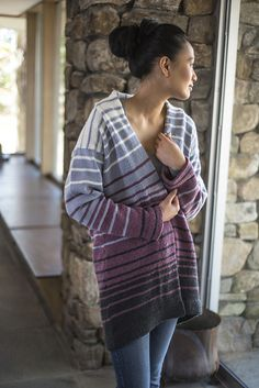Designer Julia Farwell-Clay used four shades of Berroco Ultra Wool in varying-width stripes to create a stunning knitted coat. The fronts and back of this garment are knit separately, while stitches are picked up for the sleeves and knit down from dropped shoulders.