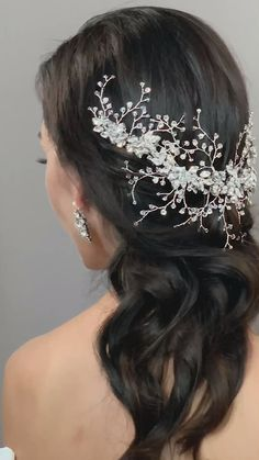 crystal royal bride regal winter wedding headdress bridal inspiration. Clusters of Swarovski crystals in the shape of leaves are the showcase of this crystal bead vine tiara.