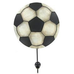 "Give your little all-star the perfect place to hang jackets, sweaters, coats, and more with this Soccer Ball Single Wall Hook! Featuring a vintage worn black and white soccer ball with a single knob-topped hook, this piece is the perfect accent for a sports-themed bedroom, a man cave, or a sporty nursery!    	     	Dimensions:    	  		Length: 10 1/2""  	  		Width: 7""  	  		Projection: 2 1/2"""
