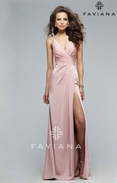 Looking for something simplistic, yet classic to wear to your next formal event? Look no further! Faviana 7755 is all you need to make a statement on your special night. This faille satin dress features a v-neck with the perfect amount of plunge. The draped front adds texture to the long skirt, while the high slit reveals just the right amount of skin. The back is adorned with thin straps and ruching that are architecturally placed to flatter your figure in all the right places. Accessorize…