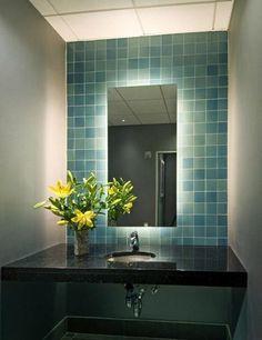Powder Room - Back lit mirror showcasing the aqua blue tiles.