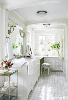 Architect Thomas Catalano and designer Chris Benson went beyond the usual his-and-hers towels and double sink in this Wellesley, Massachusetts, bathroom design. By adding a pass-through shower, they combined two rooms into one, but personalized each side for the husband and wife. Eric Roth Eric Roth  - HouseBeautiful.com