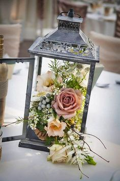 18 DIY Wedding Centerpieces on a Budget! 18 DIY Wedding Centerpieces on a Budget! Lantern Centerpiece Wedding, Centerpiece Ideas, Centerpiece Flowers, Wedding Table Centrepieces, Vintage Centerpieces, Flower Table Decorations, Vintage Table Decorations, Silver Decorations, Country Wedding Centerpieces