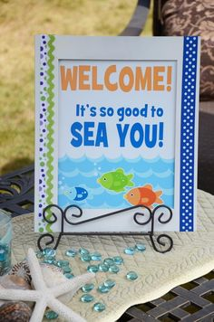 cute under the sea welcome sign - like blue glass beads on table