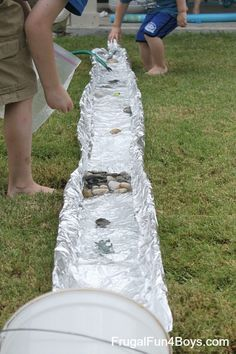 One of the very first things I pinned on Pinterest was a tin foil river.  I have often wondered if this activity would actually be worth it.  Does this actually work?  Would the tin foil hold up?  Would the boys like it?  So we decided to give it a try!  Aidan was gone at basketball …