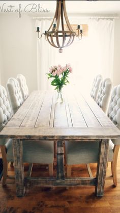 Table with tufted chairs. Love this combo of rustic and elegant