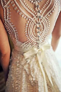 The way the back looks like a kaleidoscope. | 50 Gorgeous Wedding Dress Details That Are Utterly To Die For