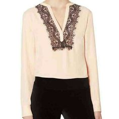 The Limited blouse Light pink with black lace. Lightweight crepe. Split vneck with eyelashed lace trim. Long sleeves with 2 button cuffs. 100% polyester. Machine wash. The Limited Tops Blouses