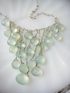 Sterling silver chain adorned with a decadent cascade of sparkling chalcedony. Adjustable length of 14 to 16 inches.