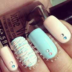Blue and cream textured nails