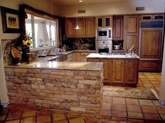 Stone around kitchen island or any other half wall. Half wall breaking up kitchen and living room space.maybe continue to be an entire stone wall that goes around the sliding door and into the kitchen around the window above sink? Rustic Kitchen Cabinets, Refacing Kitchen Cabinets, Kitchen Cabinet Design, Kitchen Redo, Home Decor Kitchen, Kitchen Remodel, Cabinet Refacing, Open Kitchen, Cupboards
