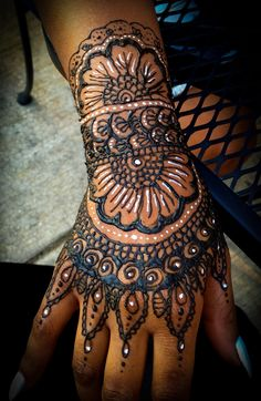 White henna and traditional henna tattoo- full hand and arm, floral design.