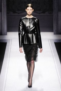 While Ferretti really dug in with black. Collarless jackets with a Matrix-like slickness topped frilled black skirts...   - HarpersBAZAAR.com