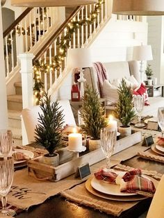 Festive Rustic Farmhouse Christmas Decor Ideas to Make Your Season Both Merry and Bright. Country Christmas Decoration ideas perfect for your holiday party this holiday season! Christmas Table Settings, Christmas Tablescapes, Christmas Candles, Christmas Table Centerpieces, Holiday Tables, Thanksgiving Table, Christmas Tree Table, Christmas Lights, Dining Room Centerpiece