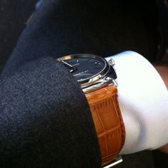 Panerai over white shirt cuff, very Italian.Men's Luminor Power Reserve Automatic Chronograph Black Alligator.