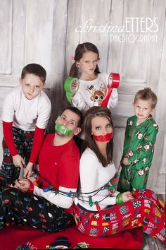 cute family christmas photo, kids take parents hostage